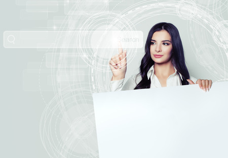 Young woman holding white empty board and pointing to empty address bar in virtual web browser. Seo, internet marketing and advertising marketing concept 免版税图像 - 105800172
