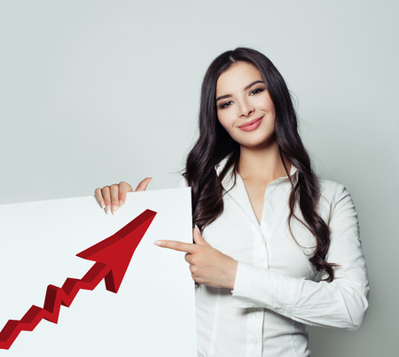 Successful Business Woman Showing White Singboard Banner Background with Red Rising Arrow, Representing Business Growth. Business Success and Shares Up Concept