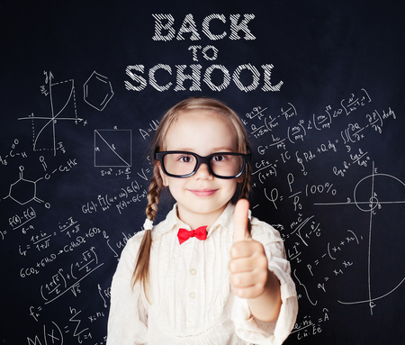 School kid thumb up. Little girl portrait, back to school Stock Photo