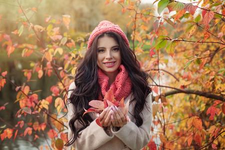 Smiling woman, colorful autumn portrait