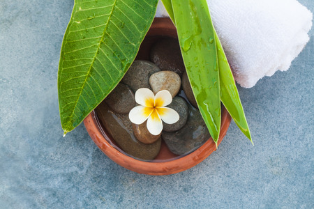 Top view on composition of spa objects and stones for massage treatment on blue Stock fotó