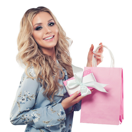 Happy fashion woman with shopping bags and gift isolated on white background Stock Photo