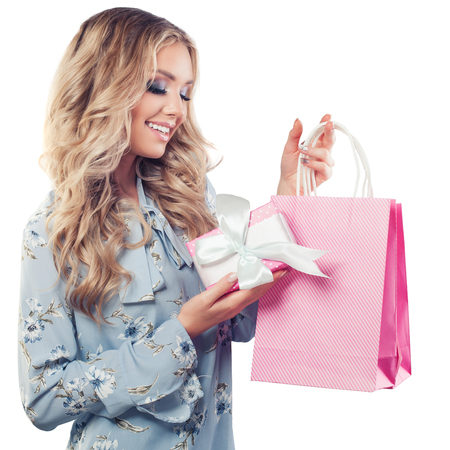 Perfect young woman with shopping bags and gift isolated on white background