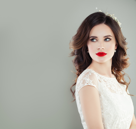 Perfect young woman bride with trendy makeup and bridal hairstyle. Pretty woman fiancee, classic style look Stock Photo