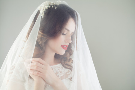 Gorgeous woman bride in romantic veil, fashion beauty portrait