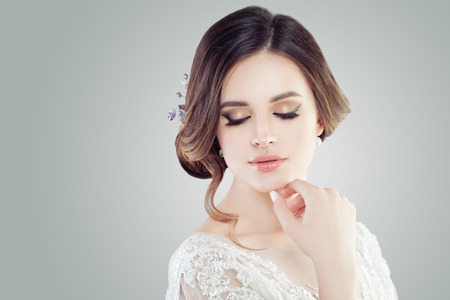 Cute young woman with makeup, closed eyes