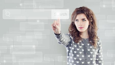 Cute woman touching empty address bar on virtual display 免版税图像