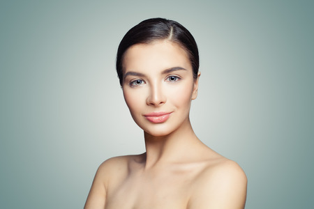 Beautiful face. Healthy woman with perfect clear skin. Facial treatment, skincare and spa concept
