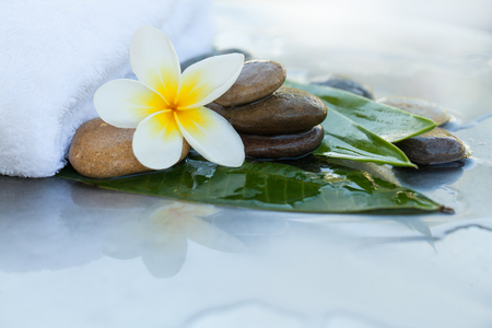 Stones, flower, towel and leaves for massage