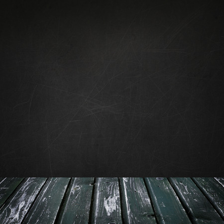 Empty background with blackboard wall and green retro wooden floor for advertising marketing and product placement