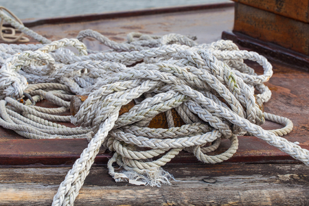 Rope on a yacht on wooden background