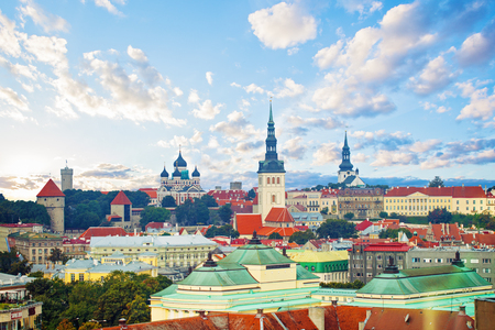 Tallinn, Estonia. Cityscape skyline of old town of touristic city Tallinn. Red roofs and colorful cloudy sky. Tallinn landmark in Baltic region. Medieval Old Town, Tallinn City Wall and Russian Orthodox Alexander Nevsky Cathedral
