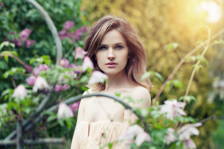 Young pretty woman in spring garden background Stock Photo