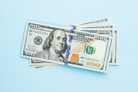 Heap of hundred dollars. Modern 100 us dollar bills on blue background Stock Photo