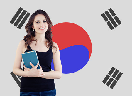 Beautiful woman against the Republic of Korea flag background. Travel, study and work in South Korea