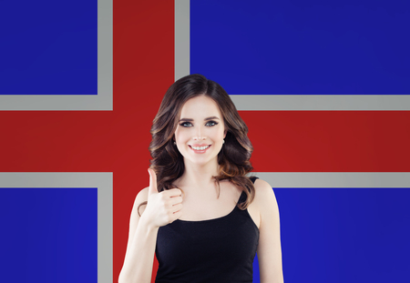 Iceland concept with happy woman against the Icelandic flag background. Travel and learn Icelandic language
