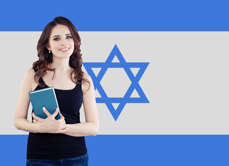 Live, work, education and internship in Israel. Cheerful pretty young woman with Israel flag