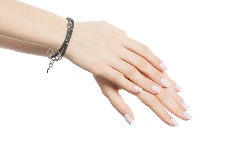 Female hand with bracelet and manicured nails with french manicure isolated on white background
