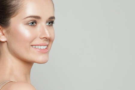 Beautiful woman with clear skin. Skincare and facial treatment Foto de archivo