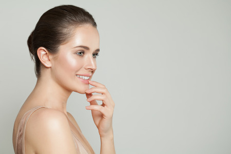 Young perfect woman with clear skin. Skin care and facial treatment