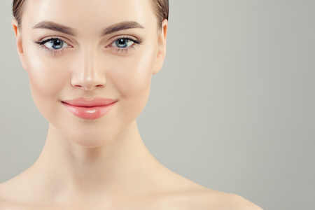 Closeup portrait of beautiful woman with clear skin