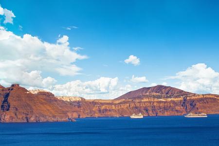Santorini caldera, Mediterranean sea and sky clouds 写真素材