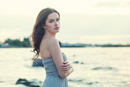 Beautiful brunette woman face outdoors