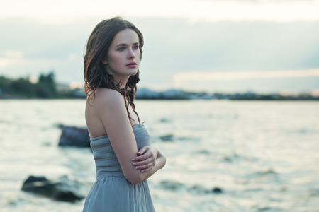 Perfect woman wearing blue dress outdoor Banco de Imagens