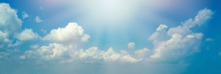 Blue sky clouds background. Beautiful landscape with clouds and sun 스톡 콘텐츠