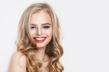 Beautiful woman laughing. Cute smiling girl with blonde hair portrait