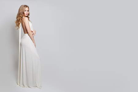 Blonde woman in white dress on white banner background