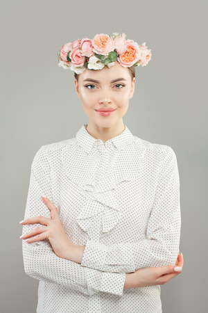 Spring woman portrait. Beautiful model girl in white shirt and flowers Imagens