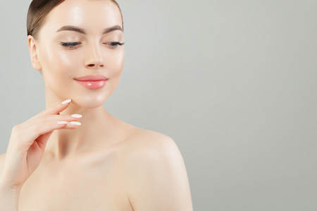 Beautiful healthy woman with clear skin. Skincare and facial treatment concept