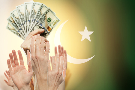 People raising hands with dollars and flag Pakistan on background. Patriotic concept