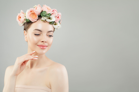 Young pretty woman spa model with roses flowers wreath on head
