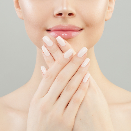 Manicure concept. Woman hands with white nails closeup Imagens