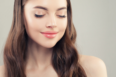 Healthy woman with perfect clear skin, face closeup