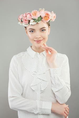 Healthy woman in flowers wreath portrait