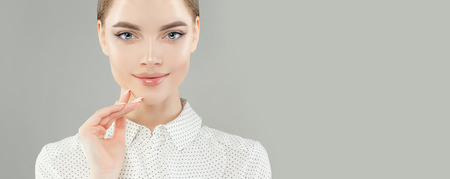Young woman face on white banner background Imagens