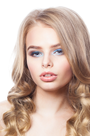 Blonde woman face. Pretty girl with curly hair