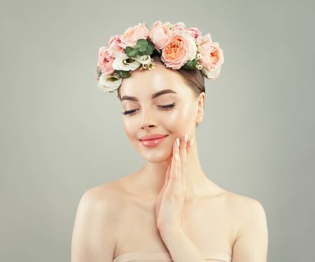 Young pretty woman with clear healthy skin and flowers, spa beauty portrait Reklamní fotografie - 124893980