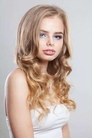 Portrait of beautiful blonde woman with long curly hair Banco de Imagens