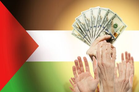 People raising hands with dollars and flag palestina on background. Patriotic concept
