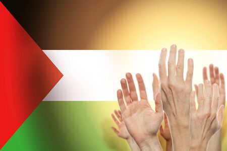 People raising hands and  flag palestina on background. Patriotic concept Imagens