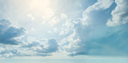 Blue sky clouds background. Beautiful landscape with clouds and sun Фото со стока