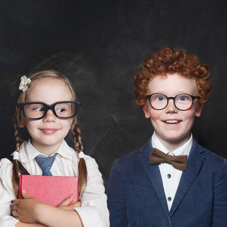 Funny children boy and girl on blackboard background