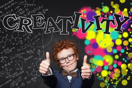 Smiling child boy showing thumb up on background with science formulas  and arts pattern