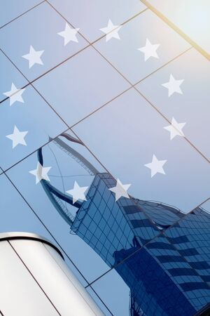 Modern office building with sign European Union on a background with sun