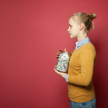 Young girl holding money. Part-time job salary, college fees, responsibility and saving money concept