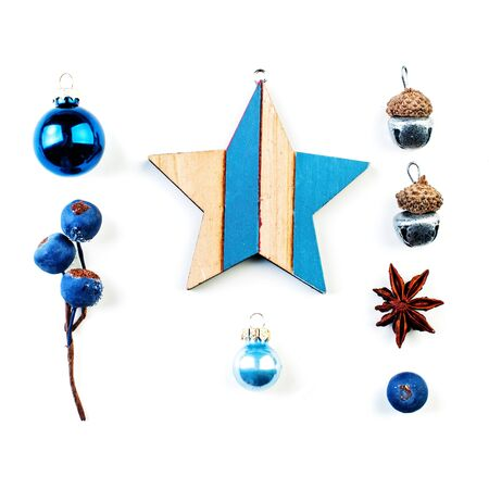 Christmas decorations isolated on white background. Wooden star, blue berries, baubles on white background Stock Photo
